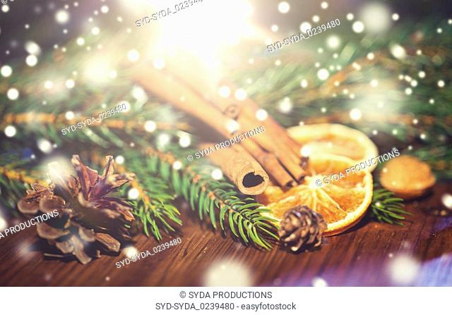 christmas fir branch, cinnamon and dried orange