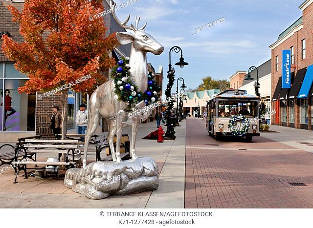 Silver deer statues decorated for Christmas at the Branson Landing shopping center in Branson, Missouri, USA