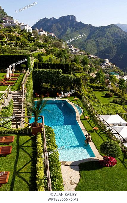 Italy, Ravello, Terrace with outdoor pool and couple kissing