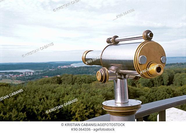 Telescope with the landscape of Rügen (Ruegen) island, Mecklenburg. Western Pomerania, Germany