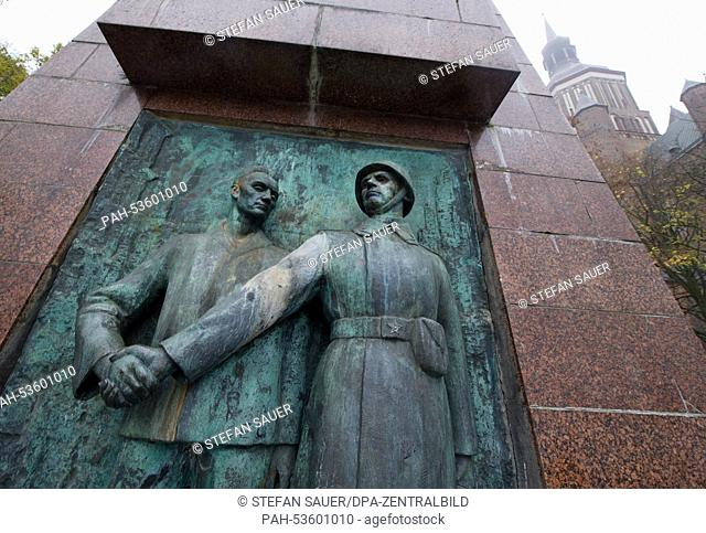 A relief with a Soviet soldier adorns the monument at the soldiers cemetery on the Neuer Markt in Stralsund, Germany, 14 November 2014