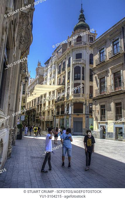 HDR image of people walking along Calle Traperia in Murcia Spain