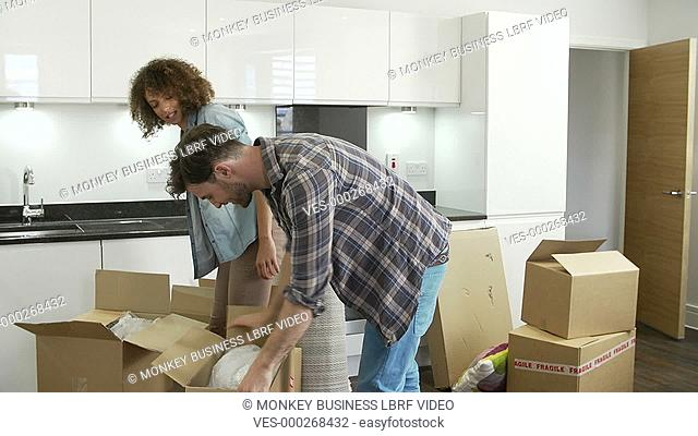 Couple unpacking boxes in new home and putting things away. Shot on Sony FS700 in PAL format at a frame rate of 25fps