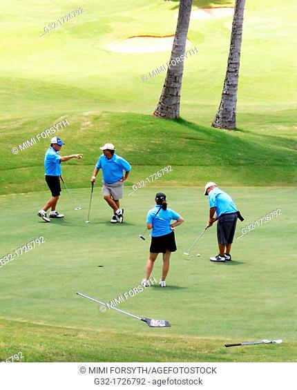 golf foursome on putting green
