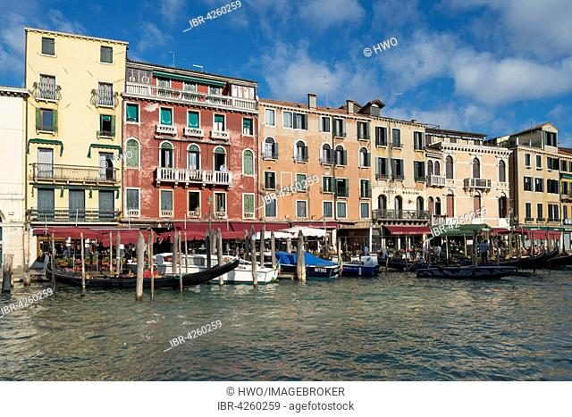 Row of houses and gondola station, by Rialto Bridge, Grand Canal, district San Polo, San Marco, Venice, Veneto, Italy
