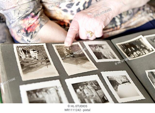 Old woman looking into photo album, close-up