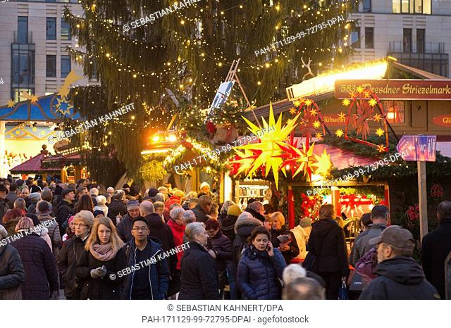 Visitors walk past the stands on the illuminated Striezel Market in Dresden, Germany, 29 November 2017. The Christmas market on the Old Market Square in Dresden...
