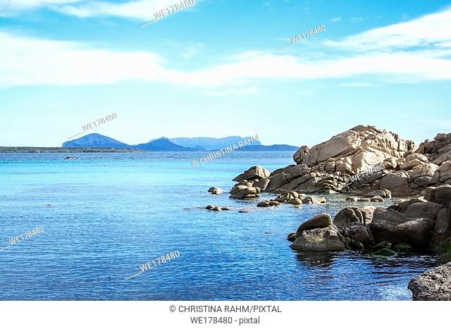 Green water and granite rock archipelago landscape on a beach in Costa Smeralda, Sardinia, Italy in March