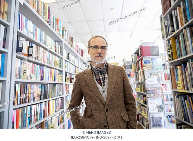 Portrait of serious bookstore owner