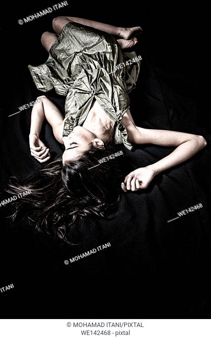 Young woman laying on the floor