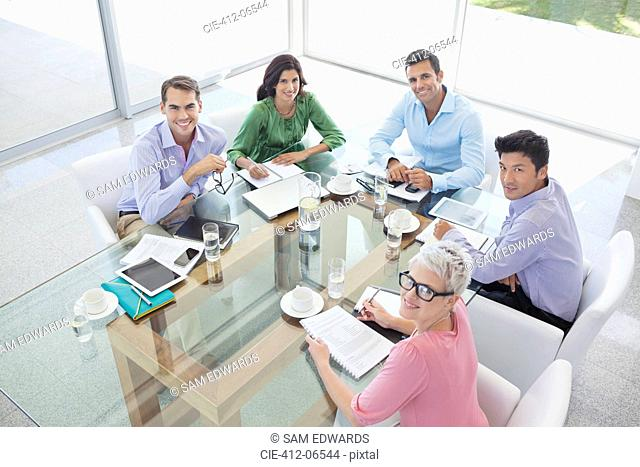 Business people smiling in meeting