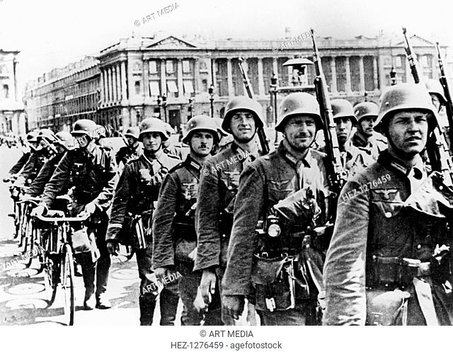 German troops marching through Paris, 17 June 1940. On 10 June the French government abandoned Paris and declared it an open city
