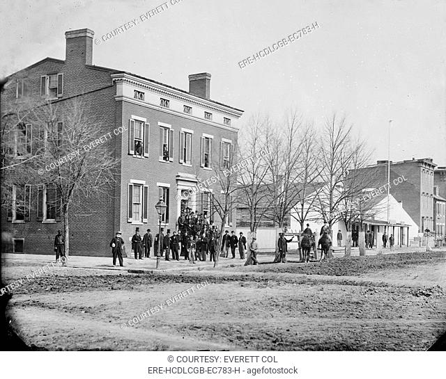 The Civil War, clerks in front of office of Commissary General of Prisoners, F Street at 20th, Washington DC, photograph, 1865