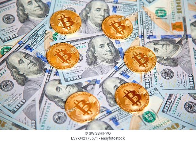 Bitcoins on the US dollar background