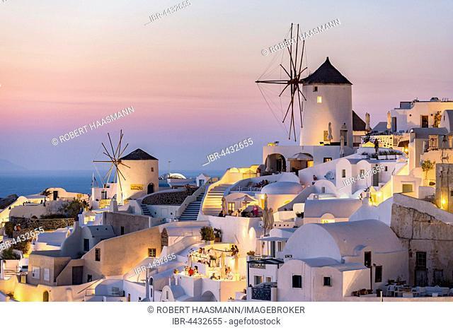 Town, windmills, dusk, Oia, Santorini, Cyclades, Greece
