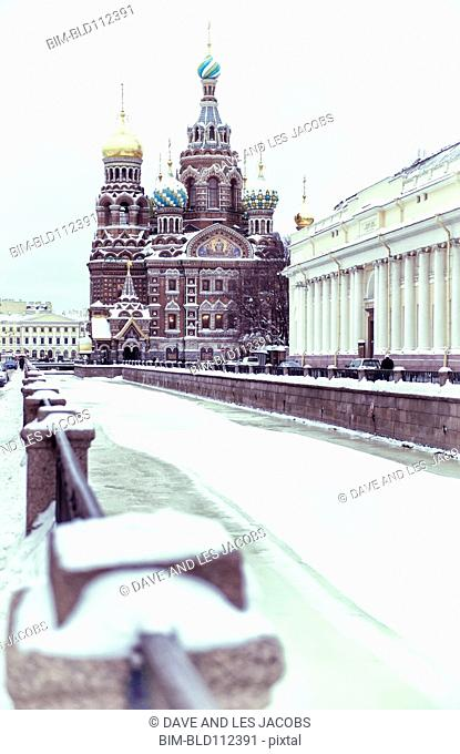 Ornate church on snowy city street, St Petersburg, Russia