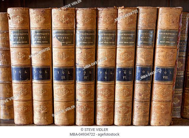 England, Warwickshire, Warwick, Warwick Castle, Bookshelf Display of Shakespeare's Works