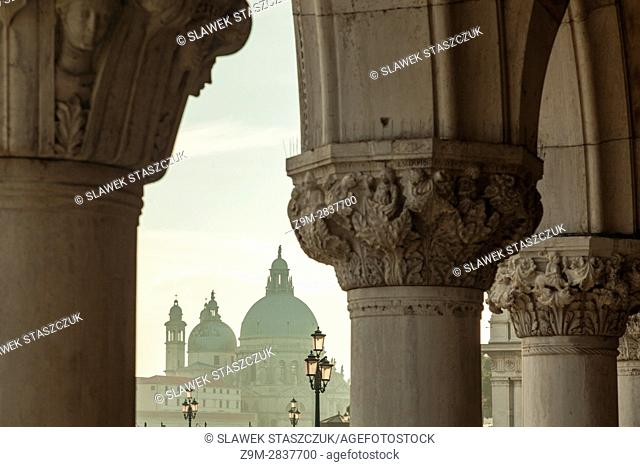 Afternoon in the sestier of San Marco, Venice, Italy. Santa Maria della Salute church in the distance