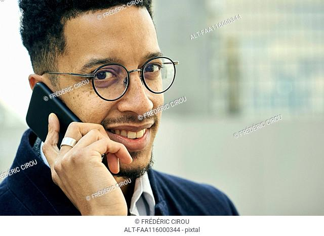 Close-up of businessman talking on smartphone