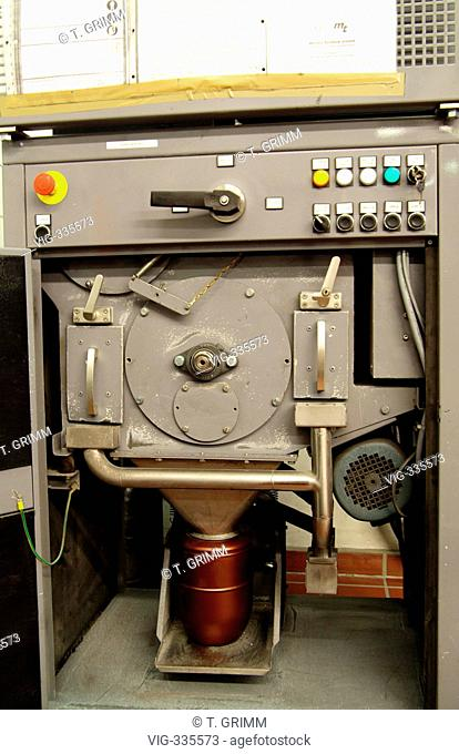 Cremation in Hamburg crematorium on the cemetery Hamburg Oejendorf. A mill crushes the remaining pieces of bones from the burner in ashes which is filled into...
