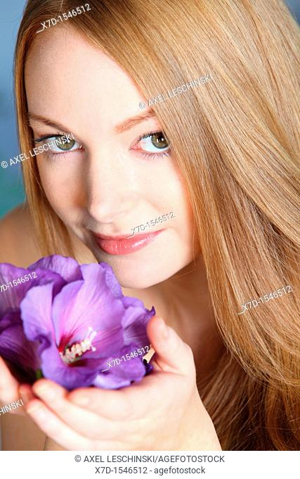 woman holding hibiscus flower