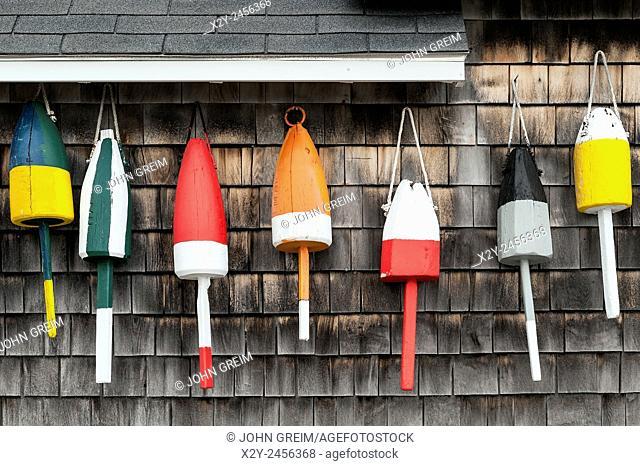 Buoys hung on the facade of a rustic coastal shack, Maine, USA