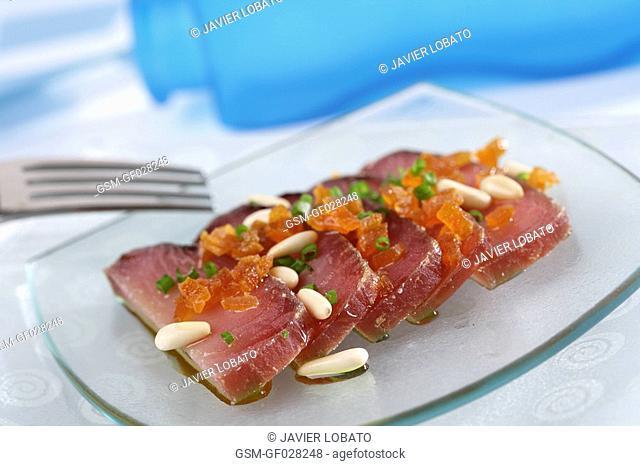Mojama dried tuna with mashed apricots and pine nuts