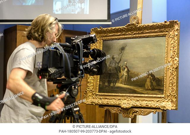 dpatop - 07 May 2018, Germany, Munich:A cameraman films the painting 'Die Weiber von Weinsberg' (lit. The women of Weinsberg) by Gerrit Bleker in the course of...