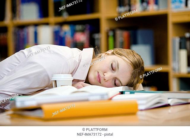 A female student who has fallen asleep Sweden