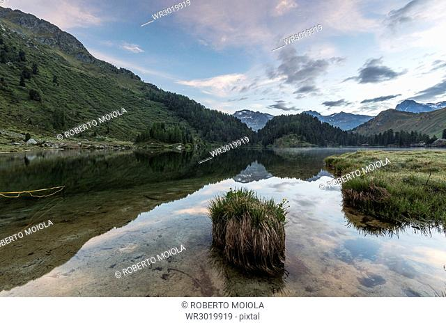 Sunrise at Lake Cavloc, Maloja Pass, Bregaglia Valley, Engadine, Canton of Graubunden, Switzerland, Europe