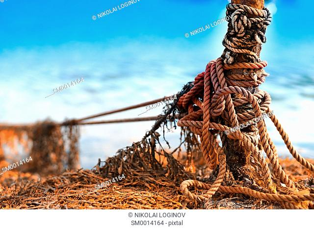 Tied up ship rope on Norway beach hd