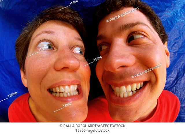 Funny portrait of couple grinning at each other