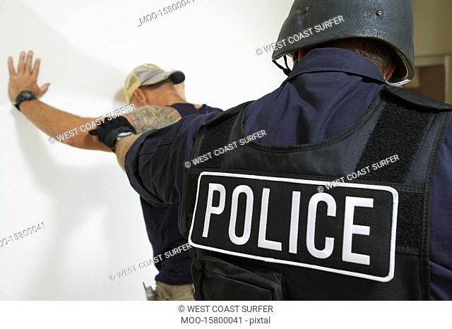 Police officer and criminal back view