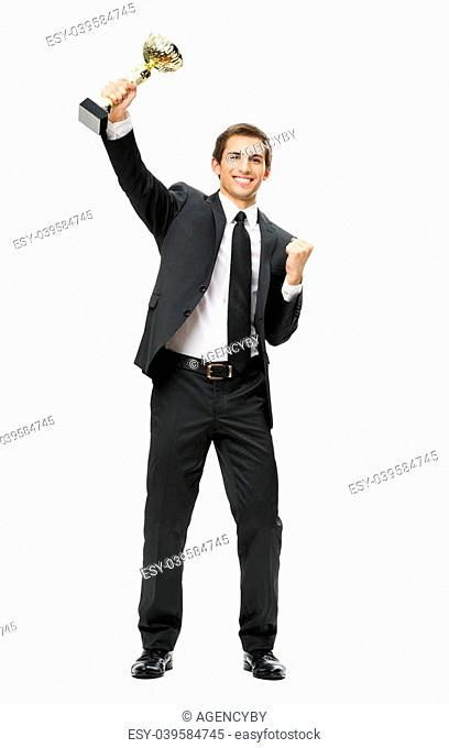 Full-length portrait of gesturing fists up business man with gold cup, isolated on white. Concept of win and success