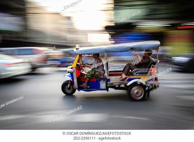 Tuk-tuk driving fast in Chinatown. Bangkok. Thailand