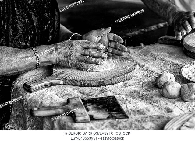 Kneading dough in a traditional bakery, detail of bread making in spain