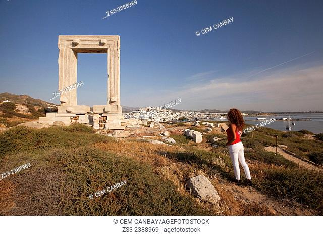 Tourist at the famous Portara door in town center, Naxos, Cyclades Islands, Greek Islands, Greece, Europe