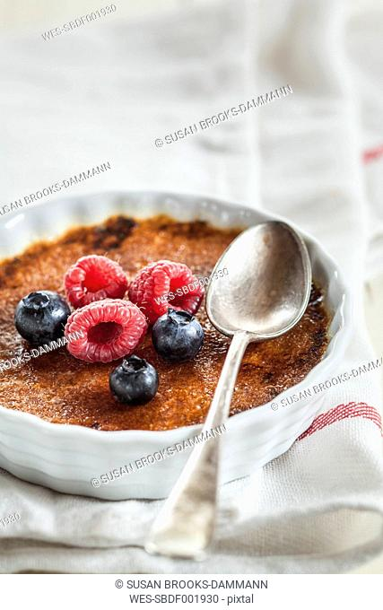 Creme brulee with berries and spoon