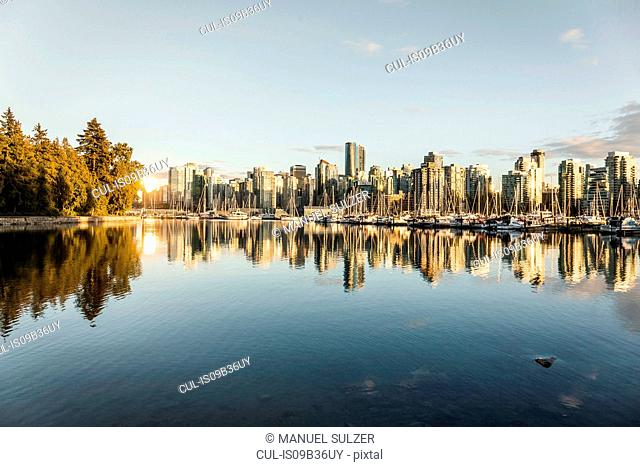 View of city skyline and marina at sunset, Vancouver, Canada