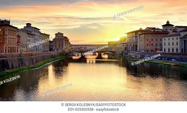 Ponte Vecchio on the river Arno in Florence at sunrise, Italy