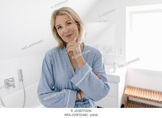 Portrait of smiling mature woman in bathroom