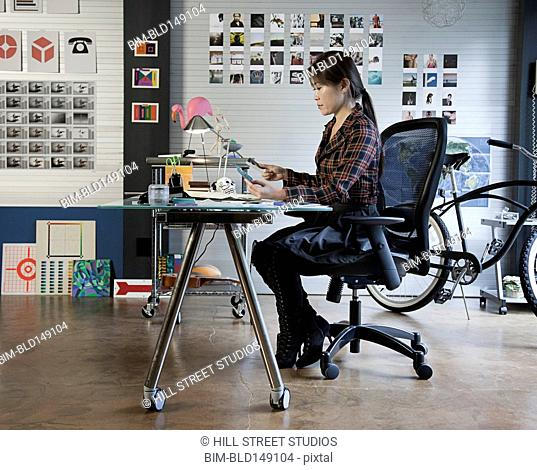 Japanese businesswoman working at desk in office