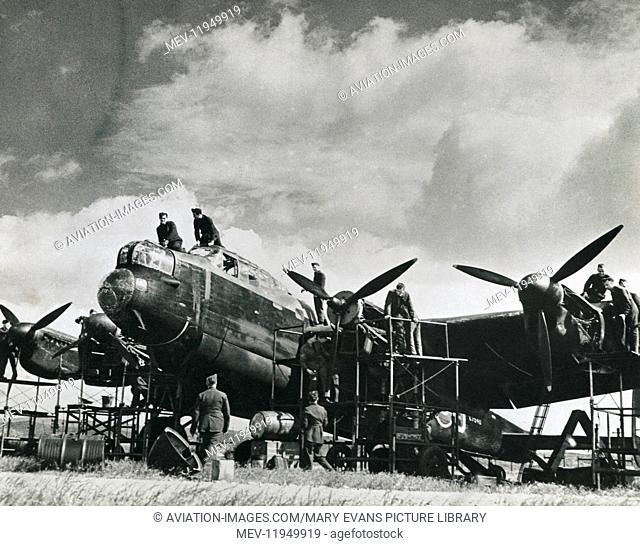 A Royal Airforce Avro 683 Lancaster Mk 1 under Maintenance with Ground Crew