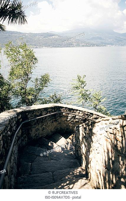 High angle view of curving stone staircase, Laveno, Lombardy, Italy