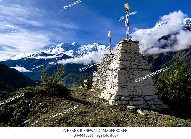 White chorten on a hill above Manang, behind Annapurna Range, Manang, Manang District, Nepal