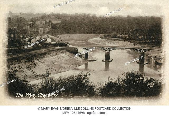 View of the River Wye (at low tide) at Chepstow, Monmouthshire, Wales. The scene is dominated by the Old Wye Bridge, constructed of cast iron during the Regency...