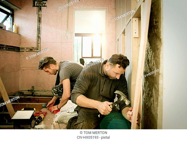 Construction workers working in house