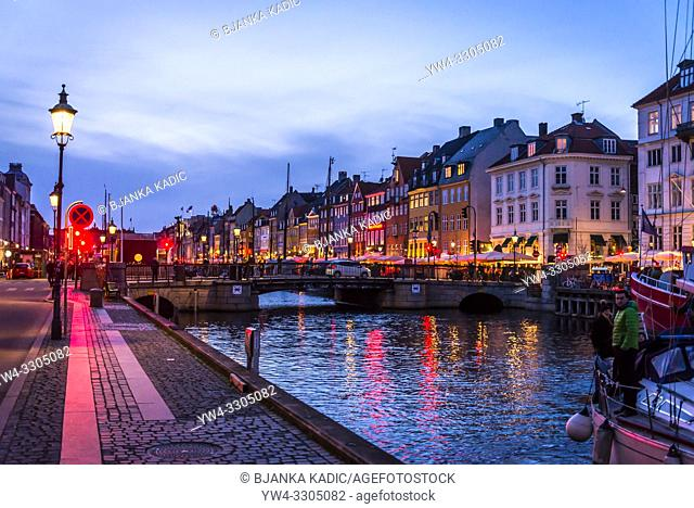 Nyhavn or New harbour is a 17th-century waterfront, canal and entertainment district lined by brightly coloured townhouses and bars, cafes and restaurants