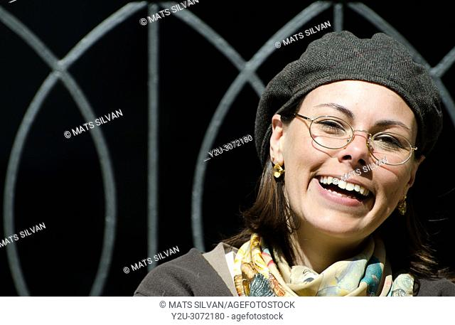 Laughing Artist Woman with Hat and Eyeglasses in Locarno, Switzerland