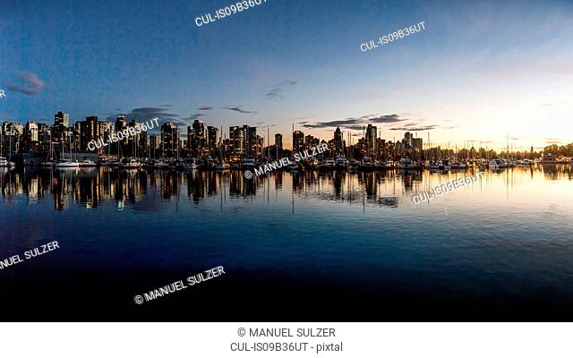 Harbour waterfront and city skyline at dusk, Vancouver, Canada